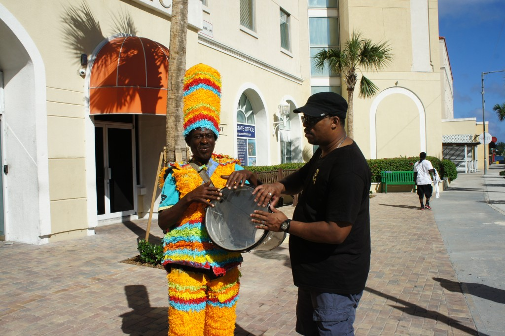 Mango Eddie celebrating with Junkanoo drum player